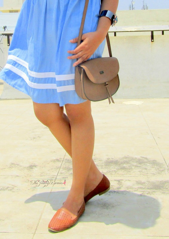 pastel blue dress tan hand bag brown loafers