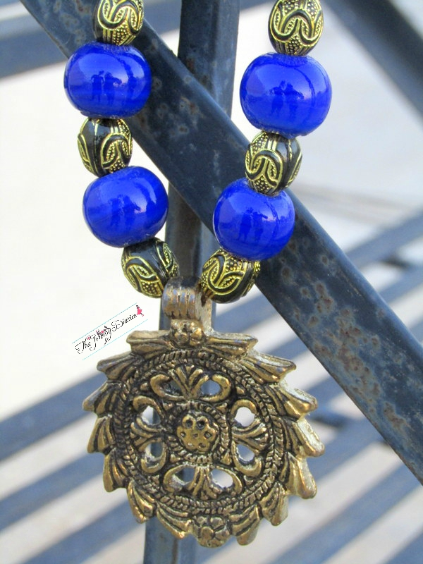 cerelean blue beads with regal antique flower pendant becklace review