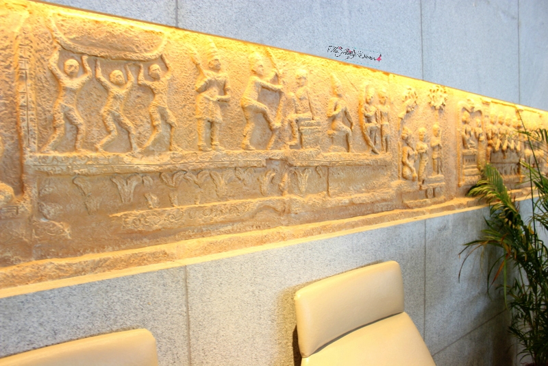 engravings on the walls of above ground level lounge bangalore