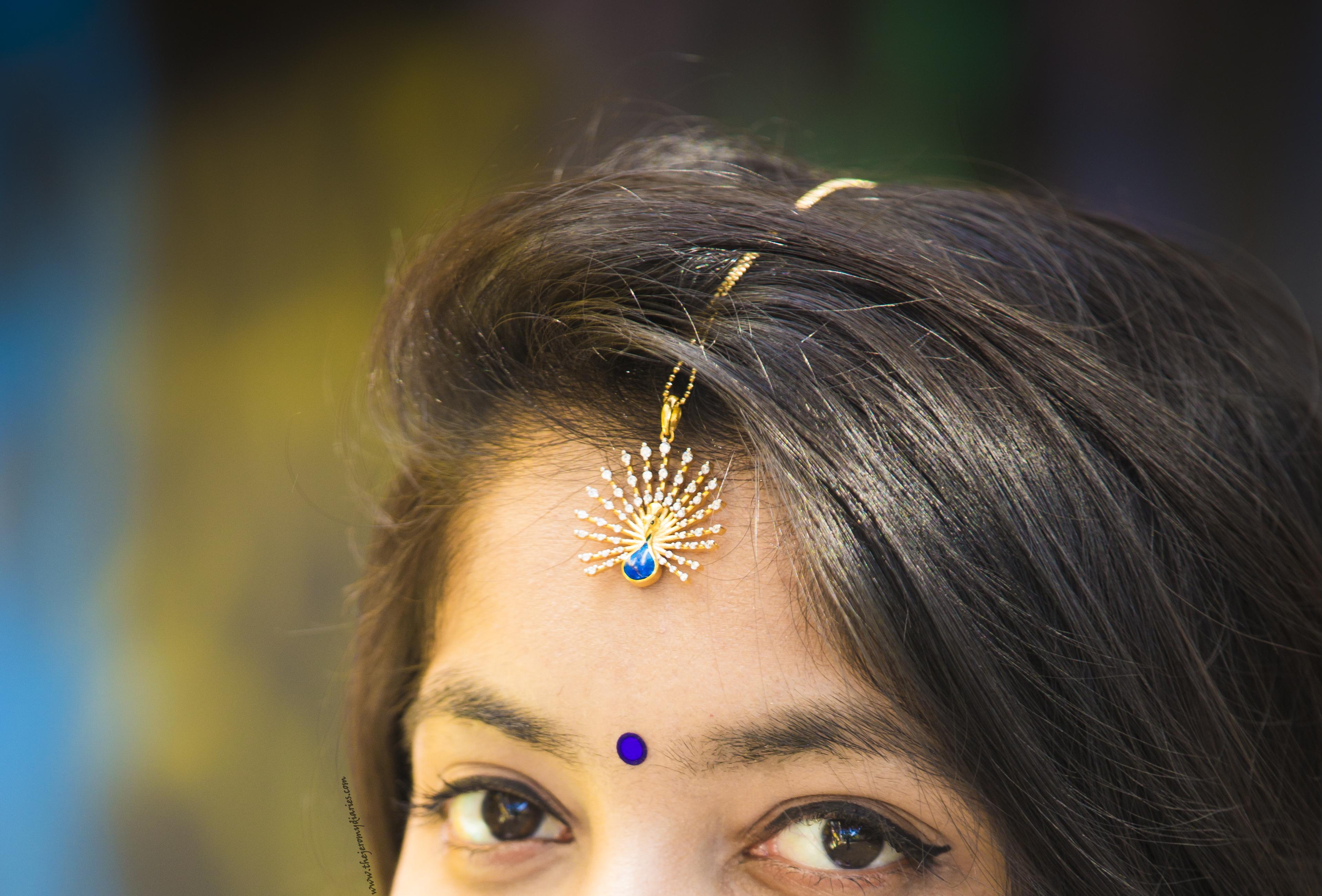 bluestone royal feather pendant as a maag tika