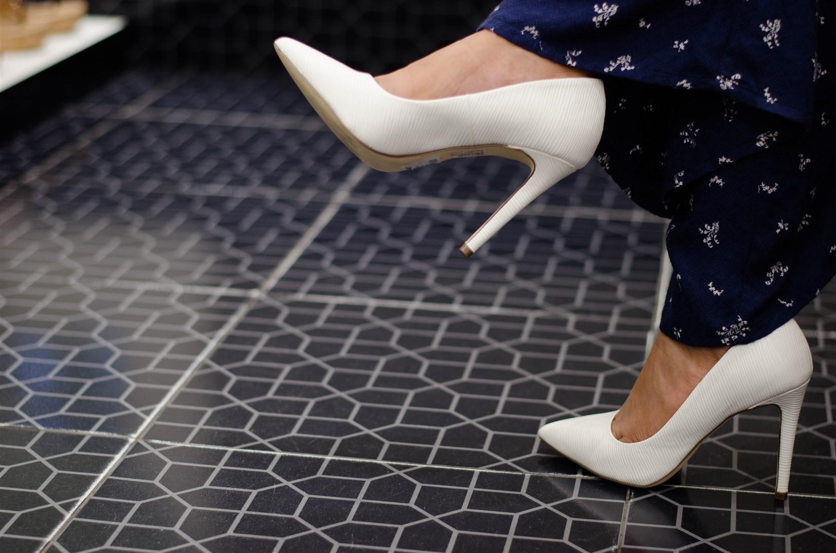 white pair of stilettos the jeromy diaries x the forum mall koramangala